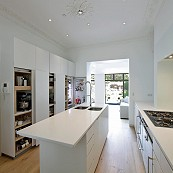 flush fitting cabinetry in white minimalist kitchen